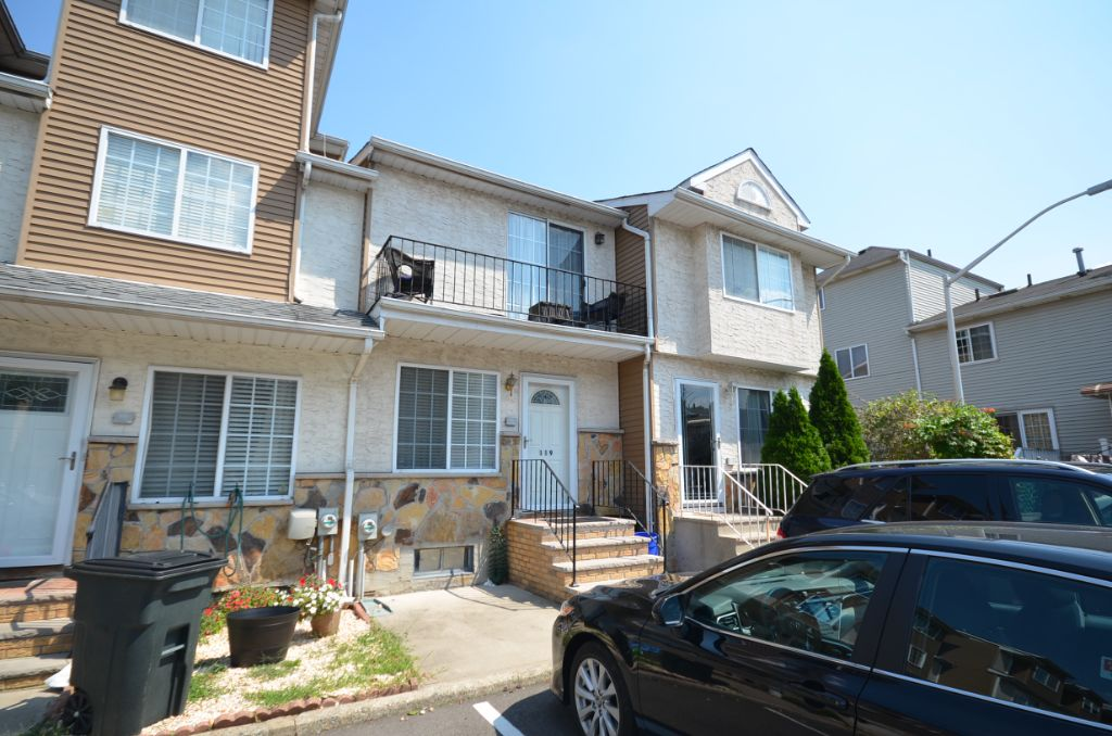 Two bedroom townhouse with private backyard and finished basement